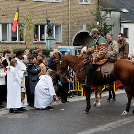Feast of St. Hubert Muno . Blessing of bread , horses, dogs , riders, ...
