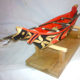 """Seal Hunting Canoe Model"" Red cedar, Yellow cedar, Acrylic Paint, Sinew"