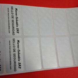 Etiqueta TMV2550, 25x50 mm, marcada con cintas premium.