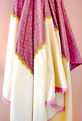 Hanging view of joined, cream velveteen & grape-coloured silk brocade Indian throw