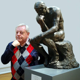John Denney with 'The Thinker' bronze sculpture
