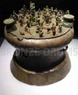 Fig. 5. Cowrie shell container with drums atop. H 55 cm (Warring States Kunming City Museum) Figurines H 10 cm.