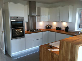 High quality gloss kitchen with soft-close units and Neff appliances