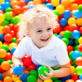 Child in ball pitt sensory therapy