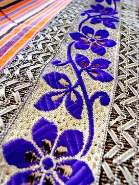 Close-up of purple & silver floral ribbon border on Indian cotton throw