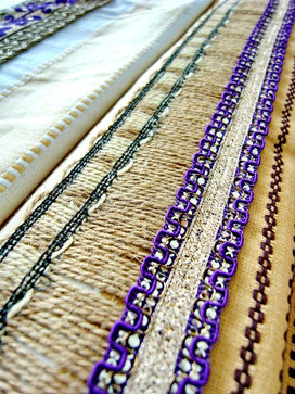 Close-up of jute trim and purple/silver ribbon, joining pieces of Indian cotton throw
