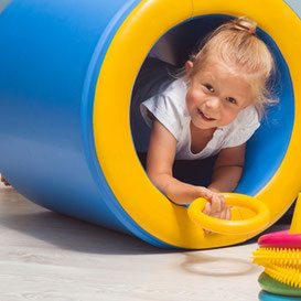 Child in sensory barrel