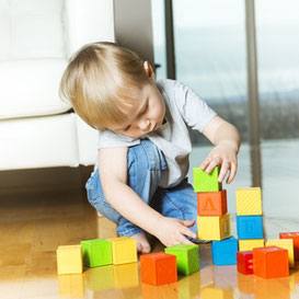 Child stacking blocks Floortime