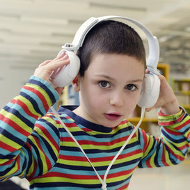 Child with headphones ILS