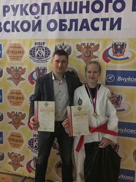 Олеся Спехова со своим тренером Евгением Омельченко
