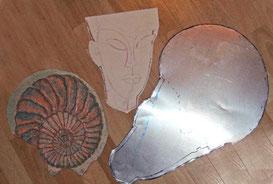 Die drei Druckplatten und der Entwurf für das Gesicht