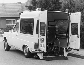 A converted wheelchair accessible vehicle with rear lowering suspension. The wheelchair inside the vehicle is secured with the first AMF-Bruns wheelchair restraint system.