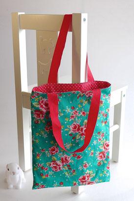 Petit sac réversible vert à pois et fleurs rouges