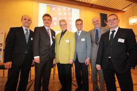 Die Referenten mit Bürgermeister Eberhard Block. V. l. n. r.: Prof. Dr. Patrick Lentz, Uwe Gotzeina, Eberhard Block, Prof. Dr. Volker Wittberg, Rüdiger Krentz, Prof. Dr. Oliver Kruse. (Foto: Kurier Verlag, M. Hütte)