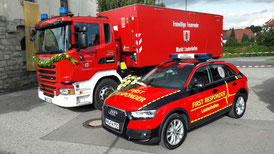 First Responder Fahrzeug und Wechselträger unmittelbar vor der Fahrzeugweihe  Fotonachweis: Aigner