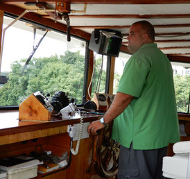 Our captain up in the wheelhouse on the top deck