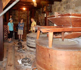 Passengers Listening to their Guide at the Grist Mill