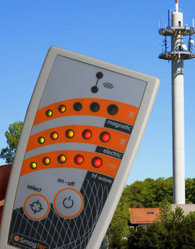 esi 24 emf detector showing high values of microwave radiation near a cell phone and radio tower.