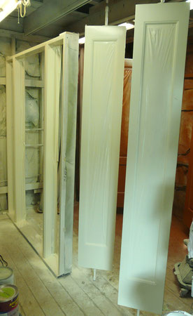 Single door frame with 2 sidelites painted