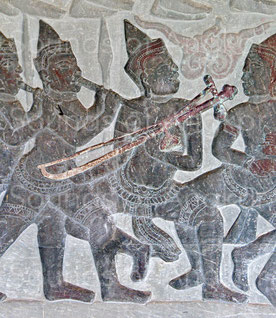 3. The only representation of a zither with its string and tuning peg. According it size and shape, the resonator could be a coconut. Angkor Wat, north gallery. 16th century.