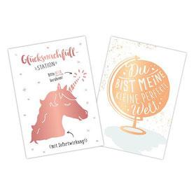 Postkarten mit den Motiven Einhorn und Globus