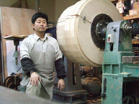 IN front of wooden lathe