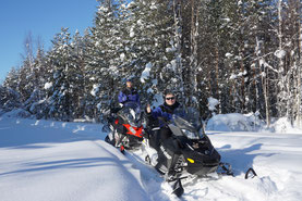 Guests on a snowmobile tour