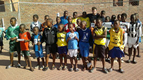 We distributed  football outfits to 6250 children aged 6 to 17 in 11 townships of Cape Town .