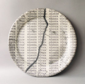 "a series of broken and reassembled plate forms bearing the text ""men kill"""