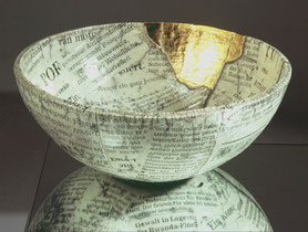 a broken and reassembled bowl form showing the good and the bad news