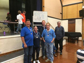The winning team helping to raise £702.37