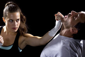 A woman defending herself in combat with Shui Tao Martial Arts against a male attacker