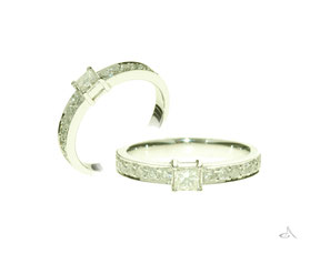 This setting was originally a pendant that was converted into a ring and diamonds added either side.