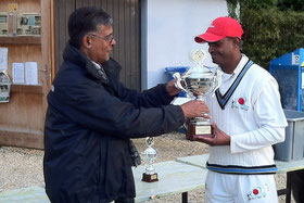 A.Koshy presents S.Sufiyan with the Champions Trophy
