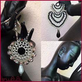 Filigranes Charm-Collier mit rot-pfirischfarbener Perlenumrandung und schwarz-weisse Ohrhänger mit facettierter Tropfenperle