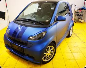 Vollfolierung Smart For Two + Rallye Streifen Firma Wrap Expert Carwrap