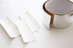 丸みを平にし、アルミテープを貼る
