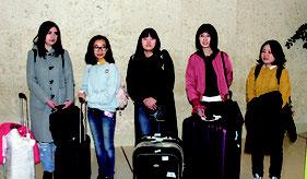 来島し、石垣で勤務する(左から)サフォノワ・ナタリヤさん、タチヤナさん、ダイアナさん、宮圓欣さん、張叶虹さん=18日、南ぬ島石垣空港