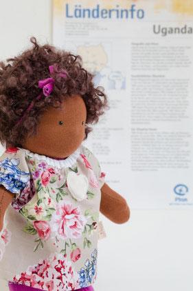 ein Plan-Patenkind für JuniKate Puppen