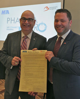 MIA's Emilio Gonzales (standing left) and Steven Polmans of BRUCargo proudly present their Letter of Intent  -  courtesy: BRU