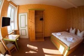 Einladend gestaltete Doppelzimmer