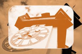 In gelb-orange abgebildeter Grazer Uhrturm - Brandschutzkonzepte und Bauplanung