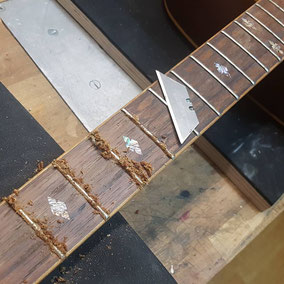 scraping fretboard