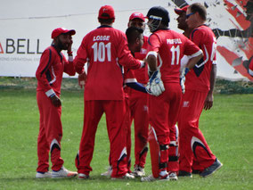 WCC fielding team come together at the fall of a wicket