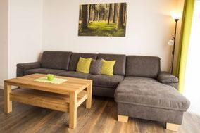 Werbefoto von einem Wohnzimmer in einem Ferienhaus an der Nordsee