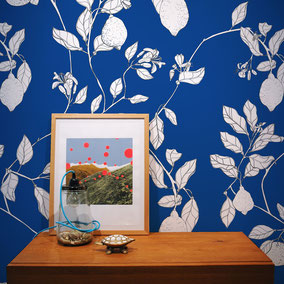 illustrated lemons on a blue ground for wallpapers and fabrics