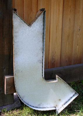 Large galvanized metal arrow