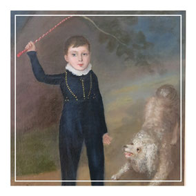 Boy with spinning top and pet poodle
