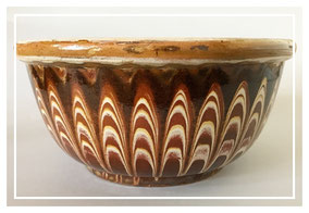 Large slipware bowl with feathered or combed decoration