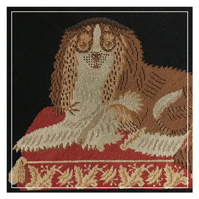 A pair of needlepoint panels of King Charles Spaniels